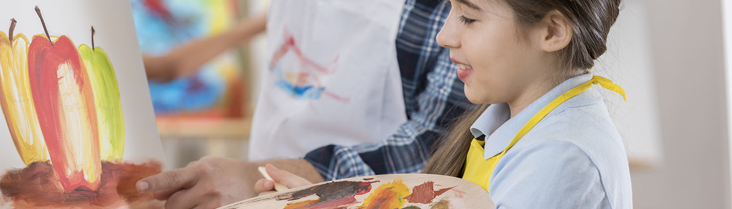 A female student in an art class at a private school